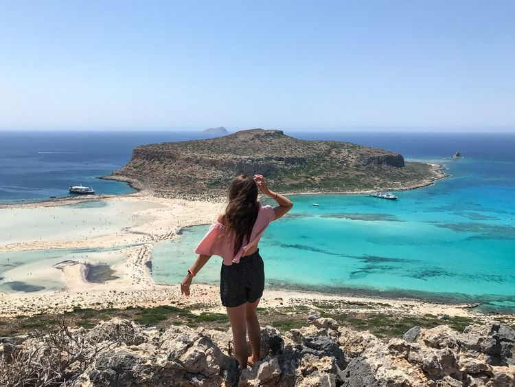 Sea Horizon Over Water Shore Beach Rock - Object Water Nature Scenics Clear Sky Beauty In Nature Real People Rear View Full Length One Person Standing Leisure Activity Tranquil Scene Young Women Lifestyles Lost In The Landscape Mountains Balos Lagoon Balos Crete Greece