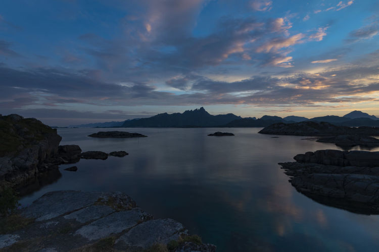 panoramic view at the Lofoten Islands Sky Water Scenics - Nature Beauty In Nature Cloud - Sky Tranquility Tranquil Scene Rock Sunset Rock - Object Solid Idyllic Nature No People Non-urban Scene Reflection Outdoors Long Exposure Sea Betterlandscapes Wanderlust Exceptional Photographs Landscape_Collection Panorama Lofoten The Great Outdoors - 2019 EyeEm Awards