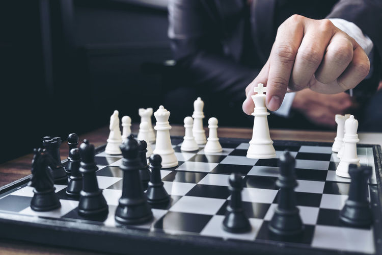 Close-up of man playing chess