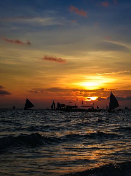 Deep orange Boracay sunset is a popular time to go sailing. Seascape Photography Sunset Silhouettes Tropical Paradise Beach Beauty In Nature Boracay Philippines Cloud - Sky Horizon Over Water Longtail Boat Mode Of Transport Nature Nautical Vessel No People Orange Color Outdoors Sailboats Sailing Scenics Sea Silhouette Sky Sunset Tranquility Transportation Water