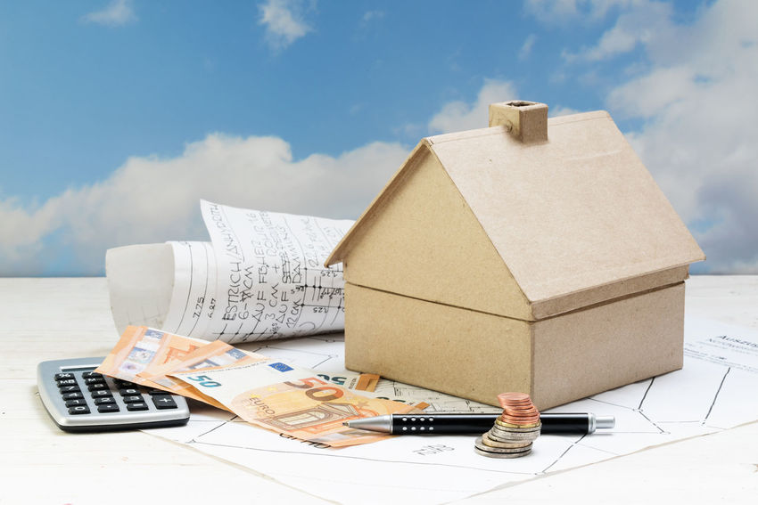 Architecture Budget Business Loan  Objects Planning Plant RISK Building Calculator Cardboard Coins Costs Day Expenses Finance House Income Investment Mortgage No People Property Real Estate Residential Building Sky