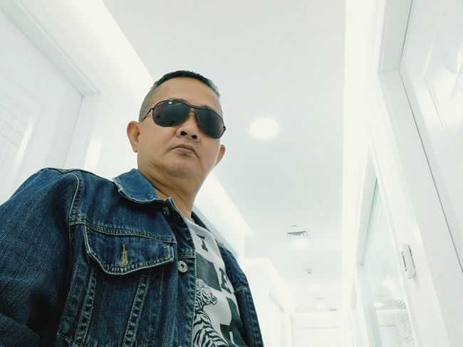 EyeEmNewHere One Man Only One Person Portrait Indoors  Cool Attitude Looking At Camera Confidence  Headshot Built Structure Photography Themes Urban Photography Architecture Indoors  Full Length Breathing Space Fashion Close-up Selective Focus