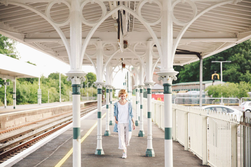 Arch Architectural Column Architecture Blonde Built Structure Casual Clothing City Life Column Curly Hair Diminishing Perspective Girl Leisure Activity Lifestyles Summer Sunset The Way Forward Tourism Train Station Train Station Platform Travel Destinations Walkway The Portraitist - 2016 EyeEm Awards Natural Light Portrait People And Places Connected By Travel Fashion Stories