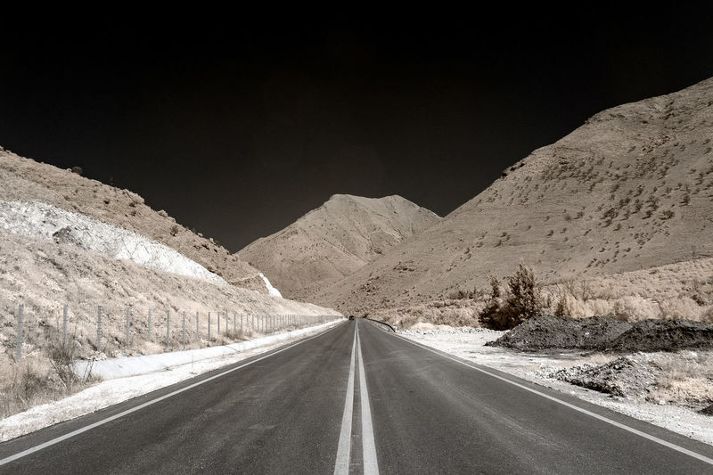 A colour infrared photo of a road through the mountains at Epirus, in western Greece. A mistake while driving brought me to this impressive place! Infrared Abstract Asphalt Clear Sky Day Empty Greece Landscape Mountain Mountain Range Nature No People Outdoors Road Scenics Sky The Way Forward Transportation White Line