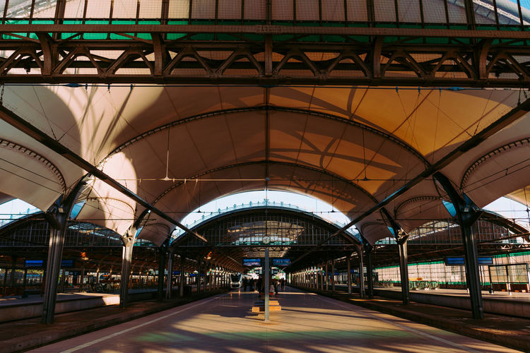 Wroclaw, Poland Railway Station Architecture Built Structure Transportation Connection Bridge Bridge - Man Made Structure City Arch Railroad Station No People Mode Of Transportation Road Day Sign The Way Forward Rail Transportation Direction Empty Indoors  Ceiling Architectural Column The Street Photographer - 2019 EyeEm Awards