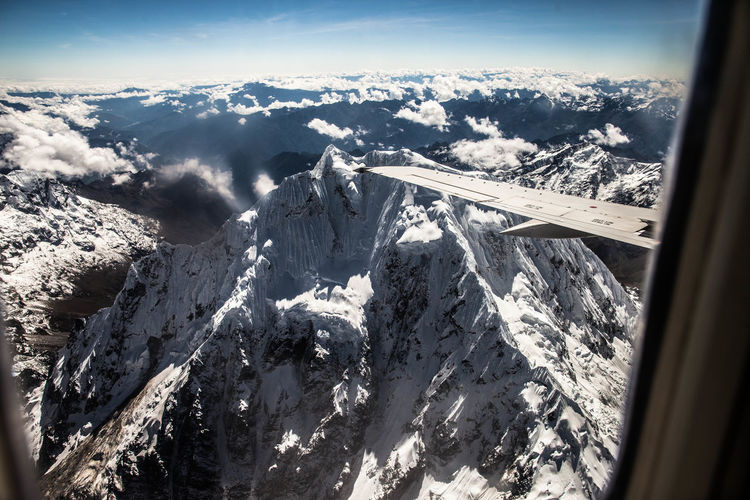 View Of Snowy Mountain From Airplane Window