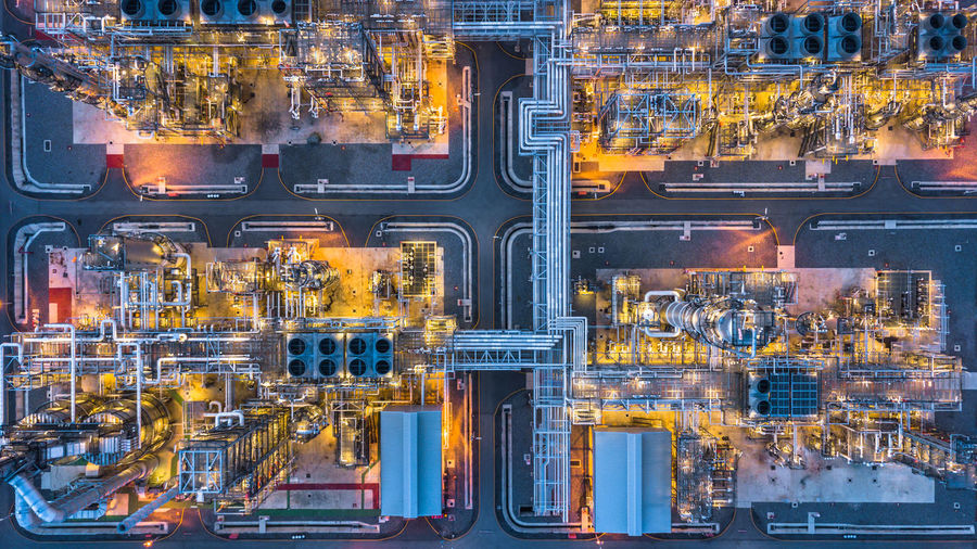 Aerial View Of Illuminated Factory In City At Night