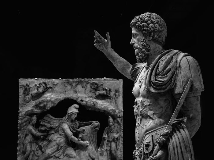Mithra sacrificing the bull to Marcus Aurelius Bnw_captures Bnw Lens Louvre Roman Empire Marcus Aurelius Sacrifice Persian Divinity Mithra Sculpture Human Representation Art And Craft Statue Representation Creativity Belief Spirituality Religion Male Likeness Craft History Black Background Indoors