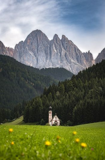 Chapel Landscape Mountain Mountain Range Chapel Tirol  South Tirol Geisler St Giovanni Alto Adige Plant Built Structure Mountain Building Exterior Building Tree Nature Grass Sky Green Color Cloud - Sky Growth No People Field Beauty In Nature Scenics - Nature