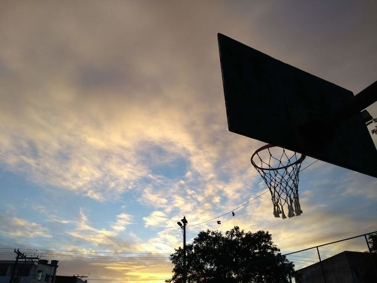 Architecture Basketball - Sport Basketball Hoop Beauty In Nature Building Exterior Cloud - Sky Dramatic Sky Dusk Low Angle View Nature No People Orange Color Outdoors Plant Silhouette Sky Sport Street Sunset Tree