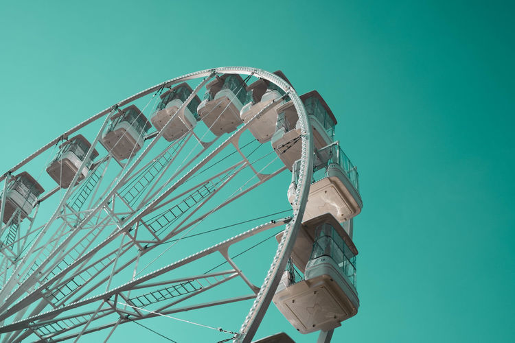 At amusement park: photo series Amusement Park Ride Amusement Park Arts Culture And Entertainment Low Angle View Ferris Wheel Enjoyment Fairground Turquoise Colored Leisure Activity Circle Outdoors Clear Sky EyeEm Gallery EyeEm Best Shots Enjoying Life