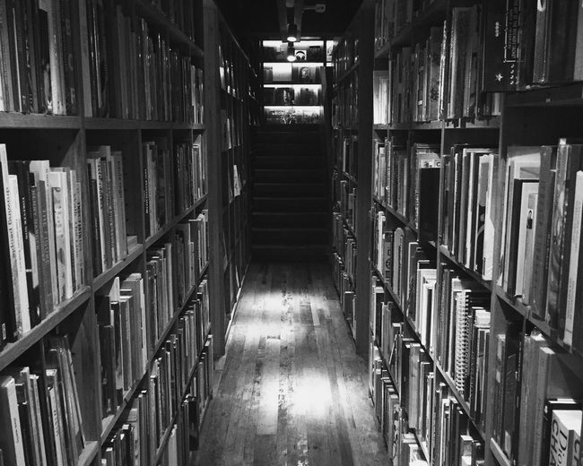 Rows Of Books On Book Shelves In Library