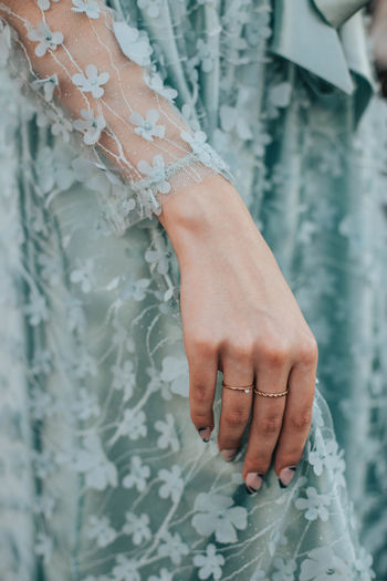 Close-up of woman hand on dress