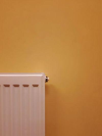 Radiator Against Yellow Wall