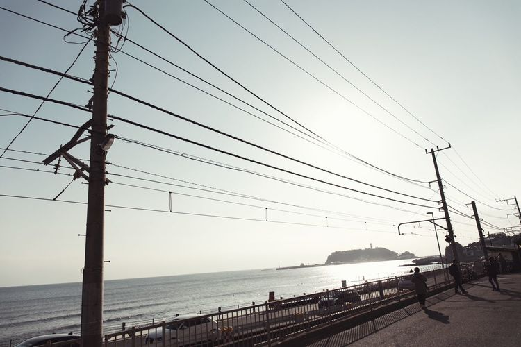 Streetphotography Vscocam Cable Connection Sea Power Line  Power Supply Electricity  Outdoors Day Sky Nature