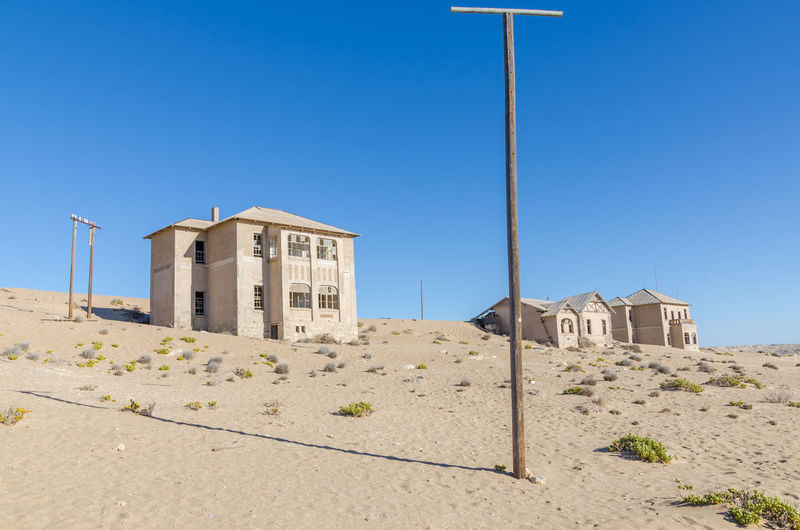 Abandoned houses filled in desert at former german mining town kolmanskop near luderitz, namibia