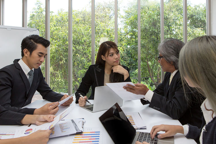 Business people discussing during meeting in office