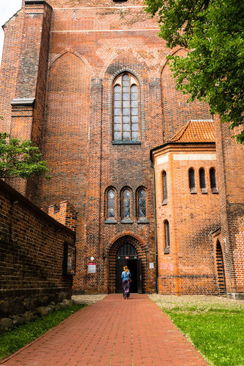 Sunday Walk II / with my DSLR - (c) Nidal Sadeq Church Fashion Lüneburg Path Adult Ancient Architecture Arch Architecture Bricks Bricks In The Wall Building Exterior Built Structure Clinker Day Full Length Lower Saxony Men One Person Outdoors Pathways People Real People Travel Destinations Walking Women