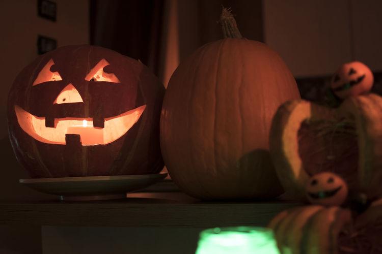 Close-up of illuminated pumpkin at home