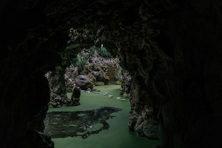 Quinta Da Regaleira Sintra (Portugal) Sintra Sintra, Portugal Rock Water Rock - Object Rock Formation Tranquility Outdoors No People Beauty In Nature Growth Flowing Water Flowing Plant Cave Scenics - Nature Solid Lake Tourism Tourist Destination