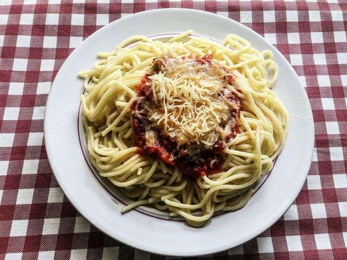 Close-up of spaghetti bolognese served on table at restaurant