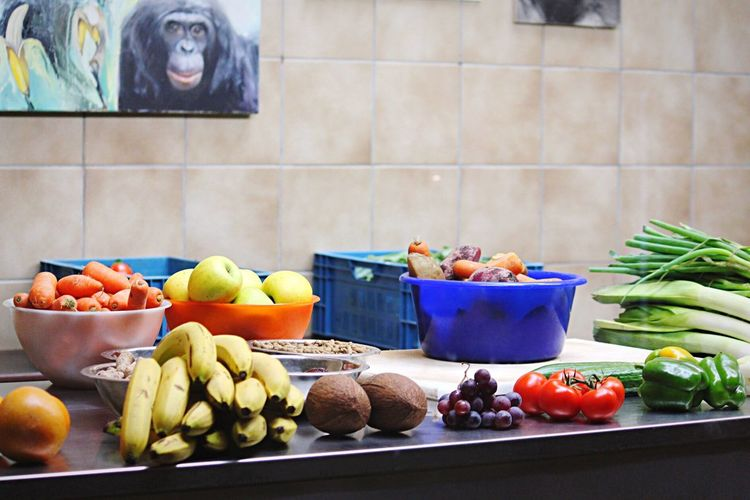 Healthy Fruits And Vegetables On Counter Against Wall