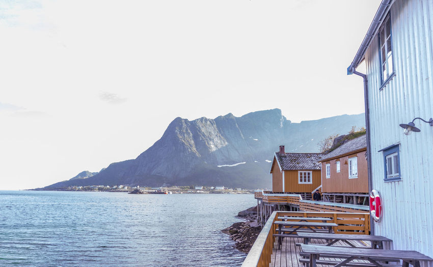 Lofoten Islands Norway Fisherman's Wharf Mountain Building Exterior Built Structure Architecture Sky Water Building Mountain Range Nature Beauty In Nature Day Scenics - Nature House Clear Sky Sea Residential District Outdoors Tranquility Bay