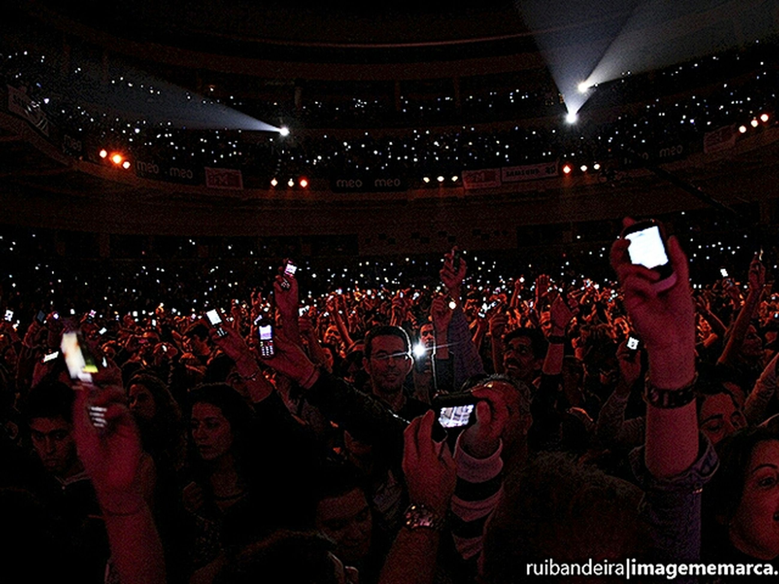 illuminated, night, lifestyles, large group of people, leisure activity, crowd, celebration, men, person, togetherness, event, arts culture and entertainment, enjoyment, standing, fun, music, performance, casual clothing