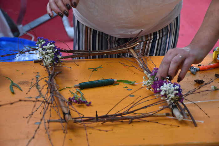 Skill  Creativity Craft Flower Flowering Plant Hand Holding Human Body Part Human Hand Midsection Occupation One Person Plant Real People Table Tool Working Art And Craft