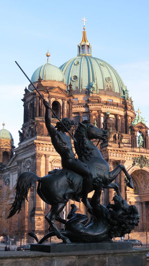 Sculptures against berlin cathedral