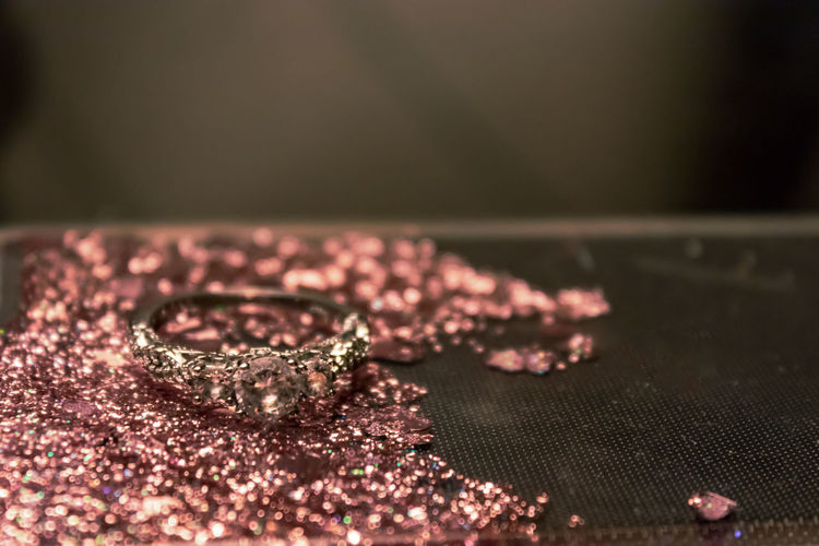 Glitter Pink Art And Craft Close-up Diamond - Gemstone Floral Pattern Focus On Foreground Food Gold Indoors  Jewelry Luxury Metal No People Pattern Personal Accessory Pink Color Ring Selective Focus Shiny Still Life Table Textile Wealth Wood - Material
