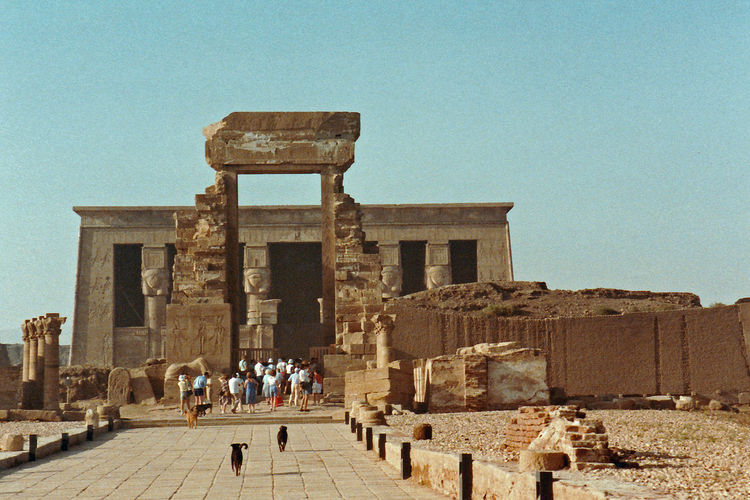 The Temple of Hathor at Dendera, Upper Egypt Architecture People Real People Men Sky Women Travel Tourism Day History Outdoors Ancient The Past Memorial Archaeology Monument Clear Sky Lifestyles Travel Destinations Ancient Civilization Large Group Of People Building Exterior Built Structure Old Ruin Architectural Column Dendera, Egypt Wall Carvings Temple Of Hathor