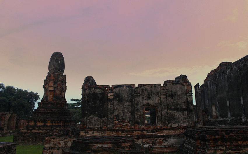 Old ruins temple against sky during sunset
