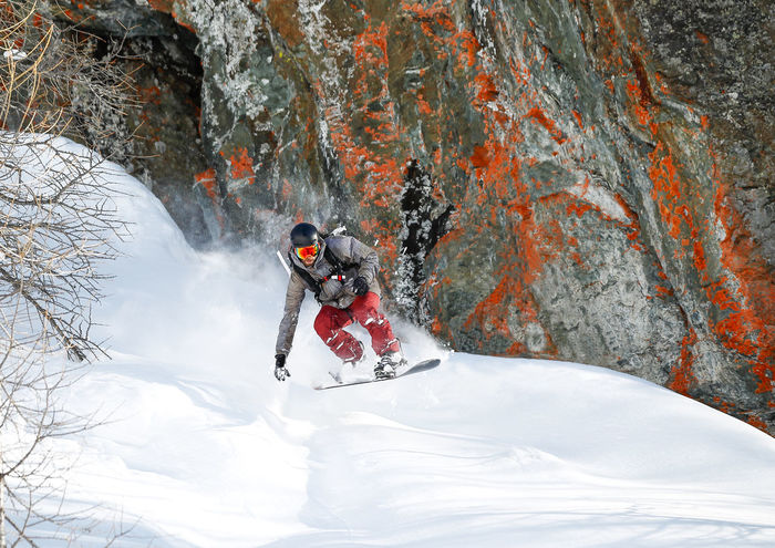 Red Rock Activity Adult Adventure Cold Temperature Day Extreme Sports Full Length Headwear Helmet Leisure Activity Men Motion Nature One Man Only One Person Only Men Outdoors Skill  Snow Sport Sports Clothing Sports Helmet Vitality Warm Clothing Winter