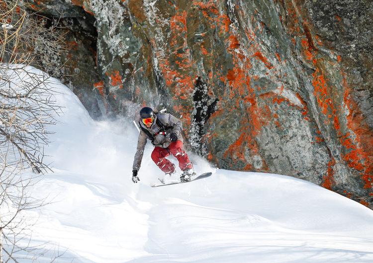 Man Snowboarding On Snow