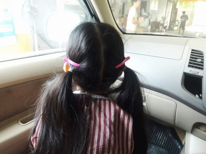 Girl in the car, concept of the child was left alone in the car, may cause suffocation, and dangerous Love And Care Transportation Vehicle Asian  Long Hair 6-7 Years Girl Alone Child In Car Dangerous Alone Girl In Car Suffocation Careful Safty Vehicle Seat City Land Vehicle Car Interior Journey Public Transportation Car Window Looking Through Window
