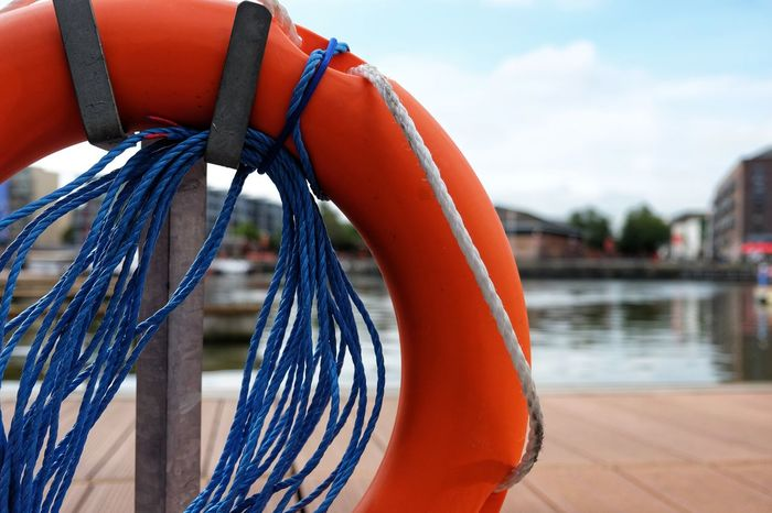 Close-up of a lifebouy in the Bristol Marina // Lifebuoy Rope Marina Nautical Vessel Orange Color Water No People Outdoors Day Moored Red Harbor Commercial Dock Close-upMulti Colored FUJIFILM X-T10 XF18-55mmF2.8-4 R LM OIS F/3.2 Iso 200 via Fotofall
