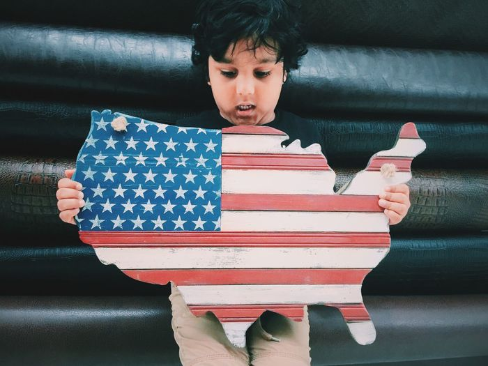 Boy Holding American Flag Map