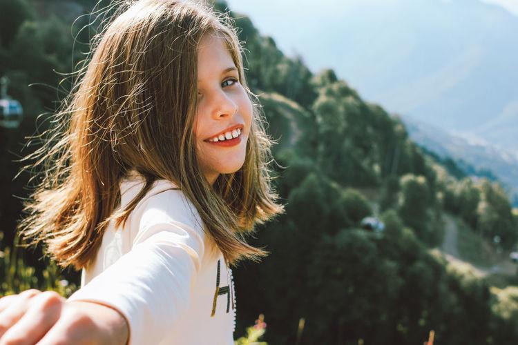 Portrait of smiling girl against sky