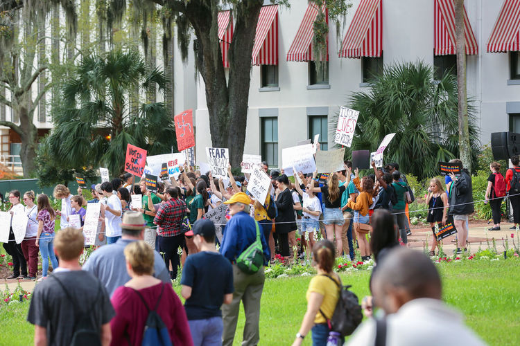 TALLAHASSEE, FL - FEBRUARY 21, 2018: Parkland students and supporters rally at Florida State Capitol for gun control. Activists and students from Marjory Stoneman Douglas High School attend a rally at the Florida State Capitol building to address gun control on February 21, 2018 in Tallahassee, Florida. In the wake of deadly mass shooting that left 17 people dead, thousands of supporters joined the Parkland students to call for gun reform. Activists Florida State Capitol Gun Lobby Marjory Stoneman Douglas High School Politics Protest Tallahassee Tallahassee, FL Brady Foundation Florida Gun Control Gun Laws Lawmakers National Rifle Association Never Again Rally Neveragain Nra Parkland Political Street Art Protect Kids Protestors Rally Shooting Tallahassee Capitol Building Tallahassee Historic Museum