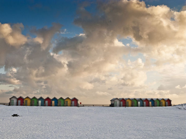 Empty beach huts in the snow of a Northumnbrian winter Beach Blyth Cloud Cloud - Sky Colorful Day Empty Huts In A Row Multi Colored No People Outdoors Scenics Seasons Sky Snow Tranquil Scene Winter