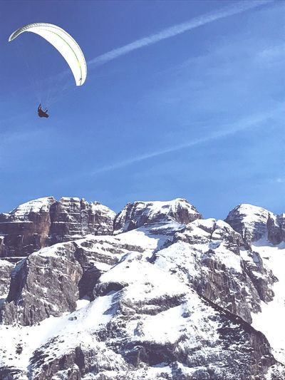 Adventure Paragliding Parachute One Person Flying Extreme Sports Leisure Activity Day Outdoors Low Angle View Freedom Snow Real People Cold Temperature Nature Scenics Mountain Sky Beauty In Nature One Man Only Beautiful IPhone IPhoneography First Eyeem Photo Silhouette