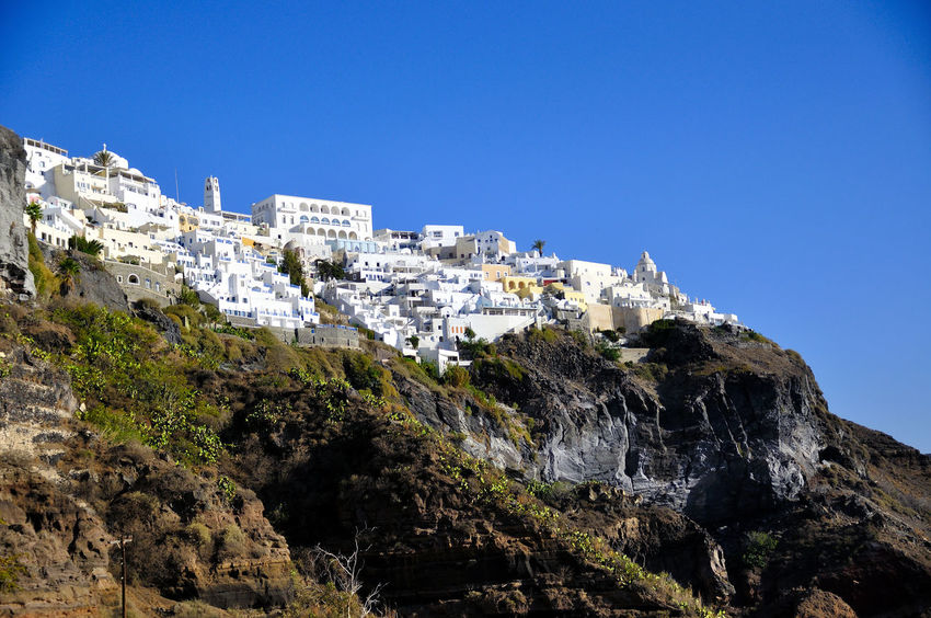 santorini grecia Grecia Santorini, Greece Architecture Beauty In Nature Blue Building Exterior Clear Sky Cliff Copy Space Day Low Angle View Mountain Nature No People Outdoors Rock - Object Rock Formation Scenics Sky Steep Turismo Isla