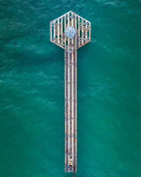 Directly Above Shot Of Pier Over Sea