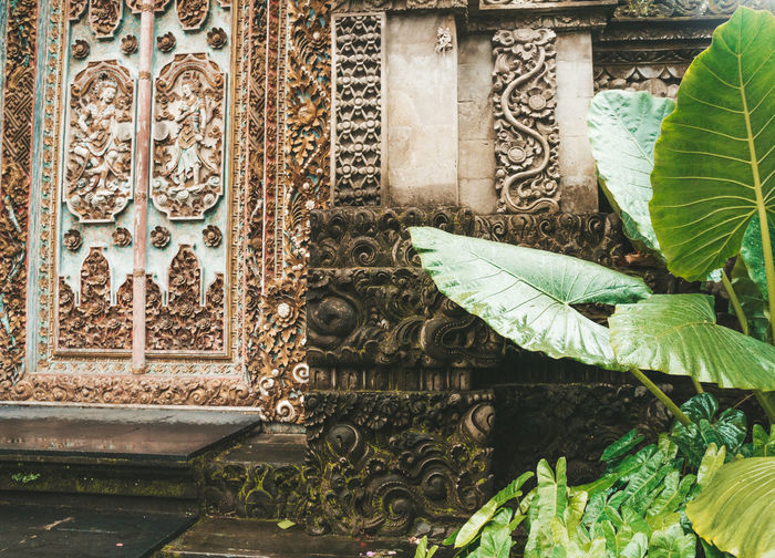 Architecture Art And Craft Built Structure Day Creativity No People Craft Building Plant Part Leaf Belief Religion Building Exterior Design Green Color Representation Carving - Craft Product Plant Place Of Worship Pattern Outdoors Ornate Carving