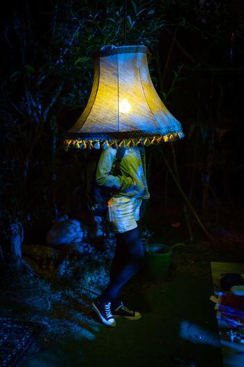 Man standing at night