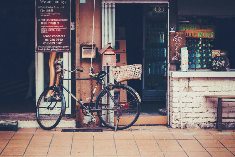 street photography in malacca, malaysia Asian  Holiday Malaysia Truly Asia Melaka Architecture Bicycle Building Exterior Built Structure City Day Land Vehicle Malaysia Mode Of Transport No People Outdoors Shop Stationary Street Photography Text Transportation Vacation