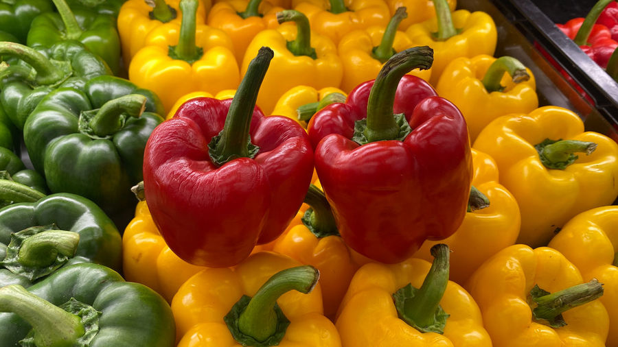 Close-up of multi colored bell peppers for sale