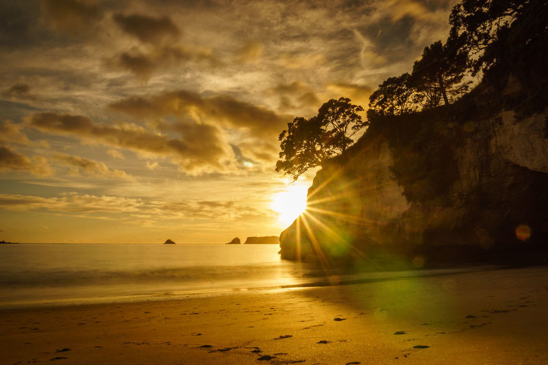 Hahei Beach Cathedral Cove Lens Flare Nature No People Outdoors Scenics Sea Sun Sunrise Tranquil Scene Water