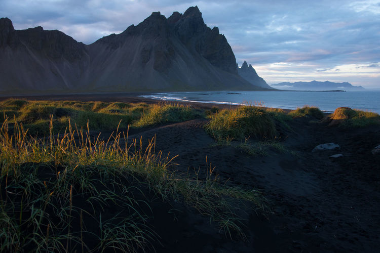 Beauty In Nature Mountain Landscape Dunes Iceland Stokksnes Travel Photography Traveling Black Sand Beach Black Sands Dunes Black Sands Island Mountain Range Sunset Magic Hour Vestrahorn Volcanic Landscape Beaches Of The World
